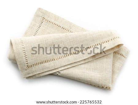 folded linen napkin isolated on a white background - stock photo