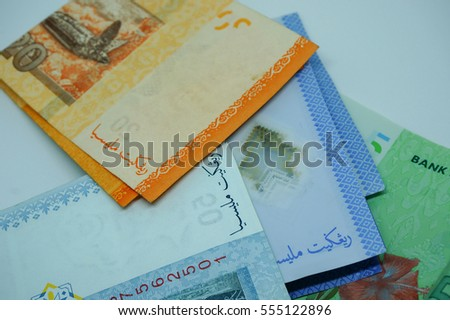 Folded Malaysia currency isolated on white background