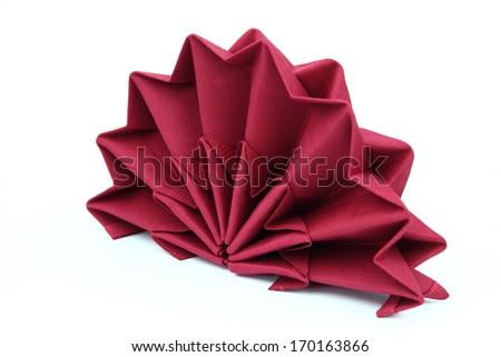 Folded napkin on the white background - stock photo