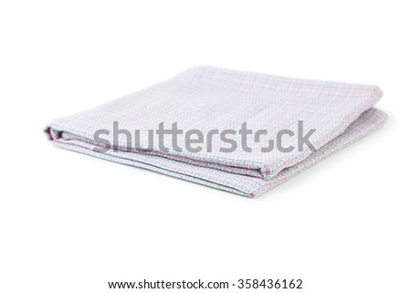 Folded napkin on white background - stock photo
