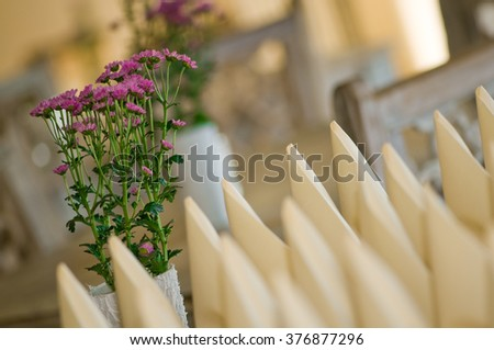 Folded napkins and flower decoration prepared for setting tables in a restaurant; Gastronomy equipment