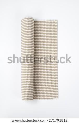 Folded natural linen napkin - stock photo