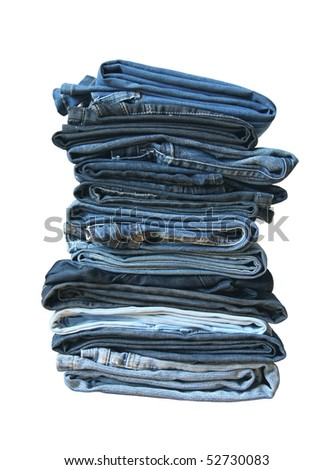 Folded old and new jeans - stock photo