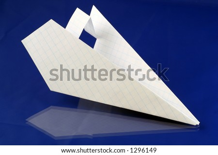 folded paper plane over blue background - stock photo