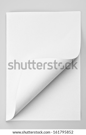 Folded sheet of paper with curled corner - stock photo