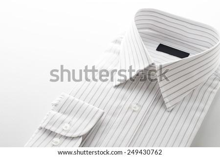 folded shirt on  white background, close up - stock photo