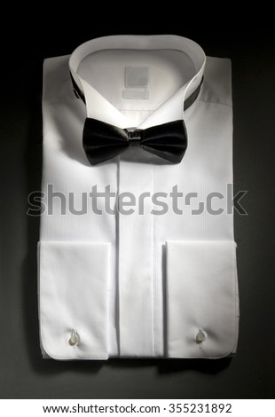 folded shirt with a bow on a gray gradient background in plan - stock photo