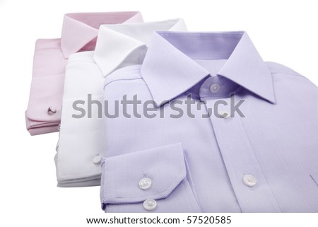 folded shirts in a row - stock photo