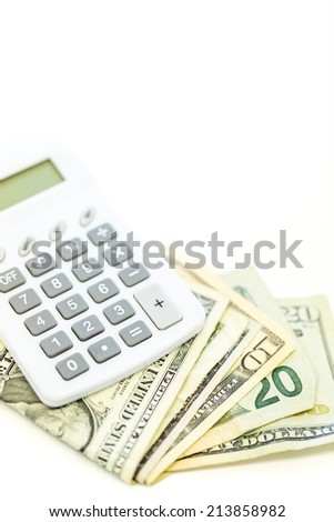 Folded US Dollars with calculator on a white background. - stock photo