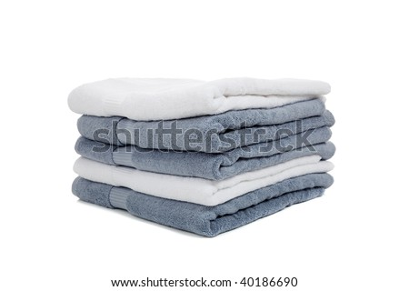 folded white and light blue or gray towels on a white background - stock photo