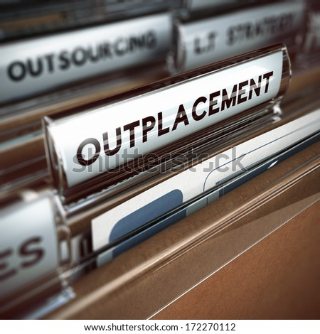 folder and focus on a tab with the word outplacement, blur effect. Concept of company downsizing.   - stock photo