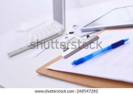Folder for papers and pen with laptop - stock photo