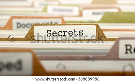 Folder in Colored Catalog Marked as Secrets Closeup View. Selective Focus. - stock photo