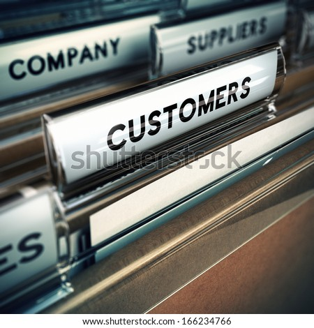 Folder tab with focus on the the word customer. Business or clients base concept image with blur effect.