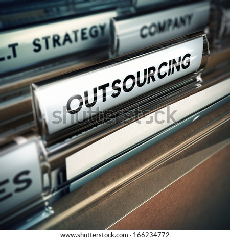 Folder tab with focus on the the word outsourcing. Contracting out or subcontracting concept image with blur effect.