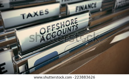 Folder tabs with focus on offshore account tab. Business concept image for illustration of tax evasion. - stock photo