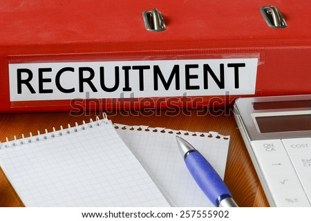 Folder with label recruitment. Folder with label recruitment and notepad, pen and calculator
