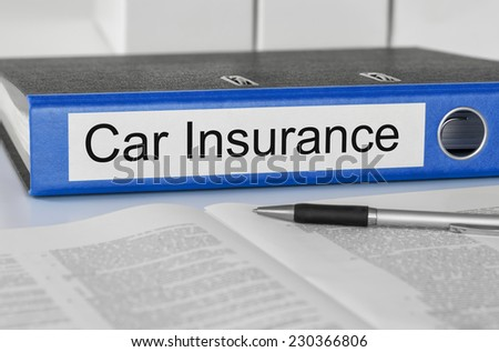 Folder with the label Car Insurance - stock photo