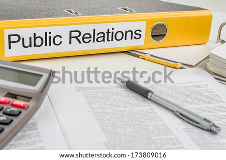 Folder with the label Public Relations - stock photo