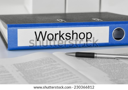 Folder with the label Workshop - stock photo