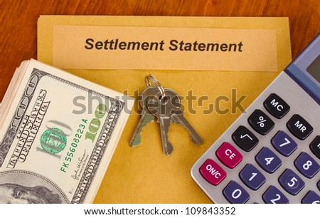 folder with the settlement statement on wooden background close-up - stock photo