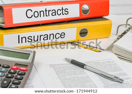 Folders with the label Contracts and Insurance - stock photo