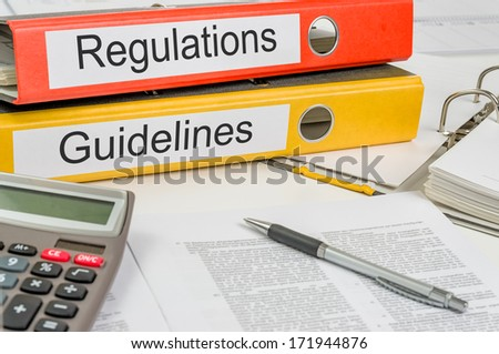 Folders with the label Regulations and Guidelines - stock photo