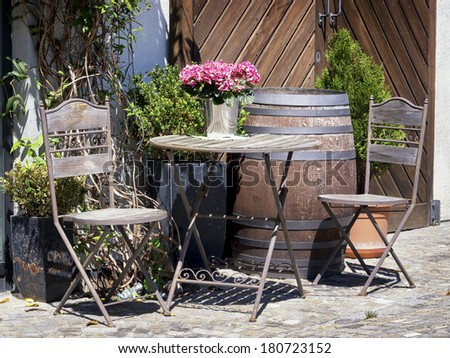 folding chair and table at a patio - stock photo