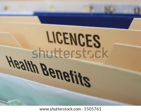 Folding file system with categories illustrating some of the elements of a busy life. Focus on Health benefits section. - stock photo