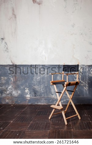 folding high chair at the wall, vintage background. vertical crop - stock photo