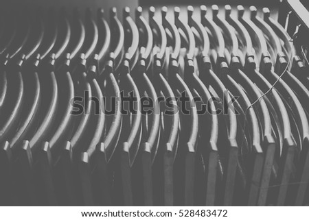 Folding wooden chairs arranged in a row. Black and white/Chairs in school