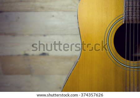 folk guitar selective focus with vintage color - stock photo