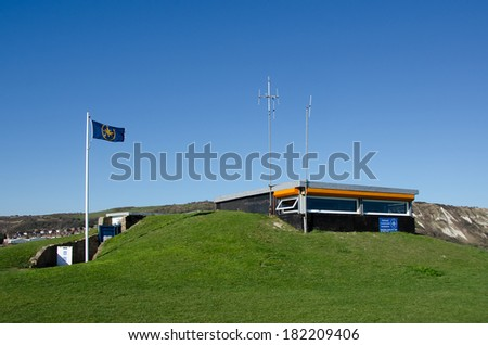 FOLKESTONE, KENT, UK - MAR 17, 2014: The National Coastwatch Institution lookout post.  The NC is a voluntary organisation providing a visual watch on UK coasts. - stock photo
