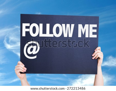 Follow Me with a copy space card with sky background - stock photo