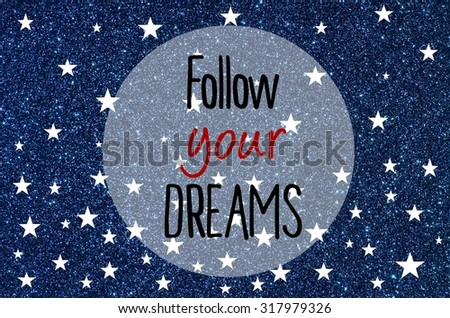 Follow your dreams motivational message over blue glitter background - stock photo
