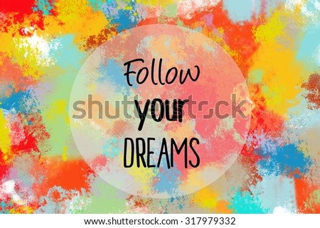 Follow your dreams motivational message over colorful painted background - stock photo