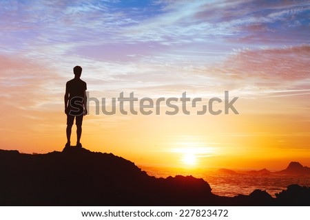 Follow your dreams, silhouette of man at sunset - stock photo