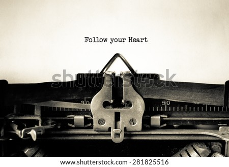Follow your Heart  message typed on a vintage typewriter  - stock photo