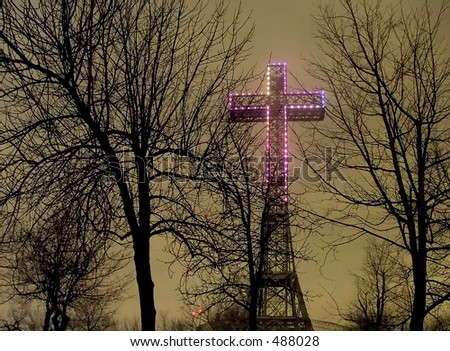 Following the death of pope John Paul II, the cross above Mont Royal was colored purple - stock photo
