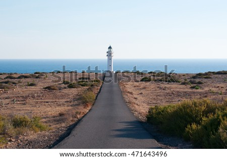 Fomentera: the road, Mediterranean maquis and Es Cap de Barbaria Lighthouse on September 5, 2010. Es Cap de Barbaria Lighthouse, located at the far southern tip of the island, was built in 1972