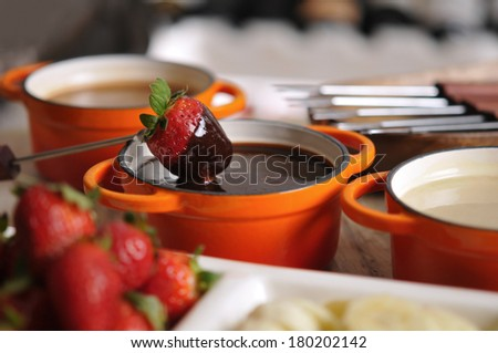 Fondue with strawberry, fruit and hot chocolate - stock photo