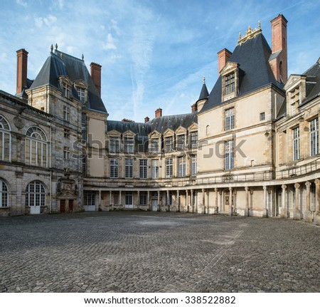 Fontainebleau, France - 16 August 2015 : Exterior view of the Fontainebleau Palace ( Chateau de Fontainebleau ). It was added to the UNESCO list of World Heritage Sites.