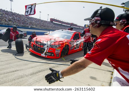 Fontana, CA - Mar 22, 2015:  Justin Allgaier (51) comes in for service during the Auto Club 400 race at the Auto Club Speedway in Fontana, CA. - stock photo
