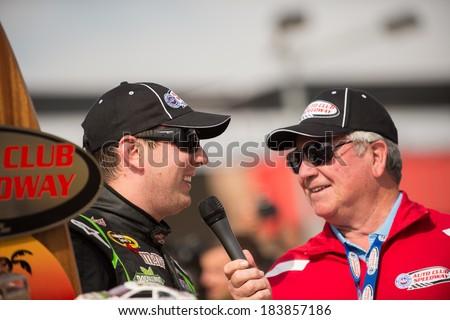 FONTANA, CA - MAR 23: Kyle Busch is interviewed after winning the Nascar Sprint Cup Auto Club 400 race at Auto Club Speedway in Fontana, CA on March 23, 2014 - stock photo