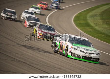 FONTANA, CA - MAR 23: Kyle Busch on his way to win at the Nascar Sprint Cup Auto Club 400 race at Auto Club Speedway in Fontana, CA on March 23, 2014 - stock photo