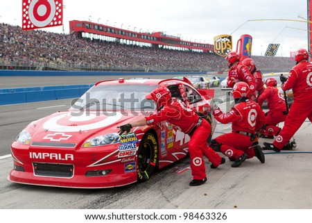 FONTANA, CA. - MARCH 27: Juan Pablo Montoya in the #42 Target Chevrolet pits during the NASCAR Sprint Cup Series Auto Club 400 on March 27 2011 at Auto Club Speedway. - stock photo