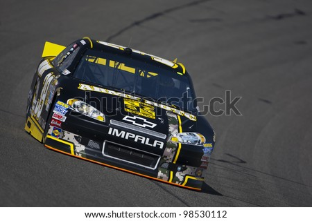FONTANA, CA - MARCH 23:  Ryan Newman (39) brings his race car through turn 4 during a practice session for the Auto Club 400 race at the Auto Club Speedway in Fontana, CA on March 23, 2012.