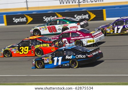 FONTANA, CA - OCT 10:  Ryan Newman, Dale Earnhardt, Jr., Clint Bowyer, and Denny Hamlin fight for position during the Pepsi Max 400 race at the Auto Club Speedway in Fontana, CA on Oct 10, 2010. - stock photo