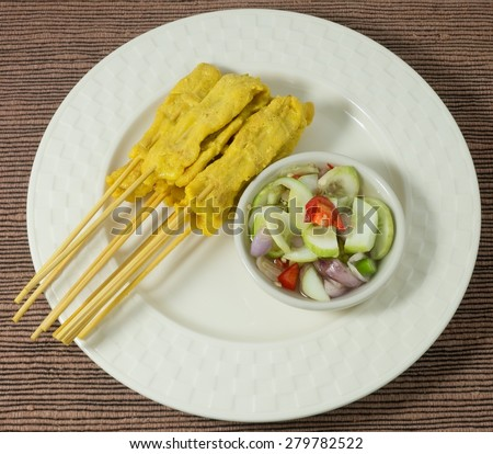 Food and Cuisine, A Plate of Grilled Pork Satay on Bamboo Skewer Served with Cucumber Salad. - stock photo