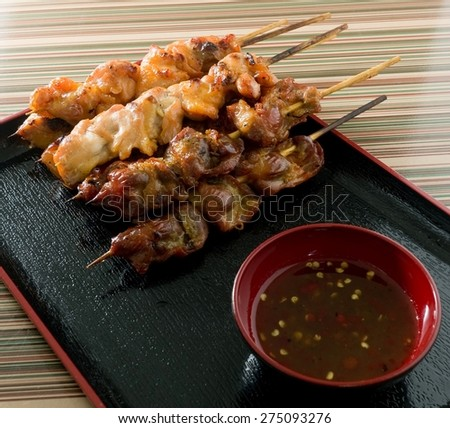 Food and Cuisine, Chicken Grilled or Barbecue Chicken on Wooden Skewer Served with Spicy Sauce. - stock photo